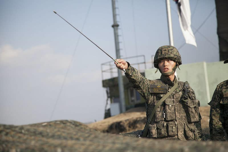 Republic of Korea Army 1st Lt. Choi Min Kyu points across the border into North Korea